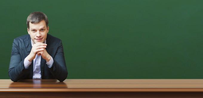 professor against chalkboard background